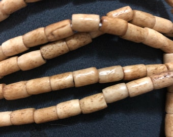 Bone African Syncurus Caffer natural bead 8x5mm