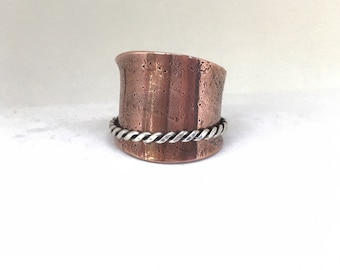 Textured copper extra wide spinner ring with a twisted silver wire spinner band in size 8