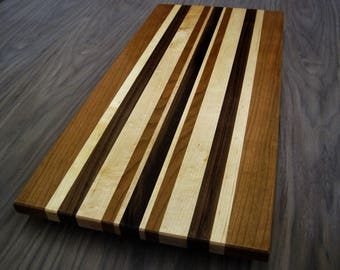 Maple, Cherry and Walnut cutting board.