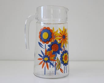 Glass pitcher with flower decoration