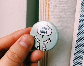 "I Don't Care - 1.25"" pinback button"