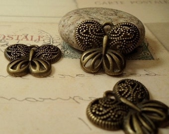 8 pcsof Antique Bronze Filigree Butterfly Charms Pendants Drops A53-Rd5