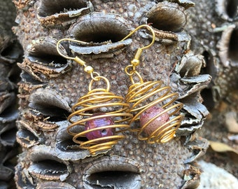 Spring cage earrings - gold