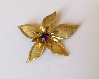 Vintage Gold Tone Textured Sculptured Flower with Large  Purple Rhinestone Center Brooch