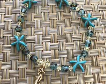Gold Plated Seahorse with Turquoise colored Starfish and Swarovski Crystals Bracelet