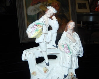 STAFFORDSHIRE FIGURINE with Man and Woman