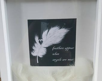 Feathers appear when angels are near memory/memorial frame
