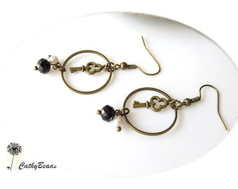 Earrings bronze, the key to happiness