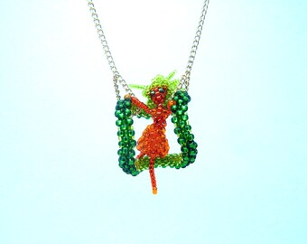 Fire Dryad seed bead pendant necklace - unusual green and orange nymph figure on a swing - beaded jewelry on a chain - handmade beadwork