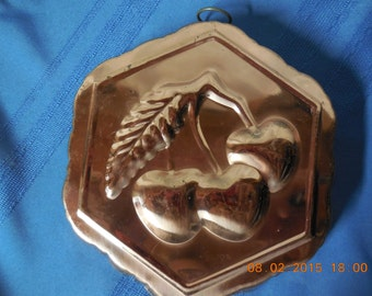 Vintage copper jello mold and wall hanging.