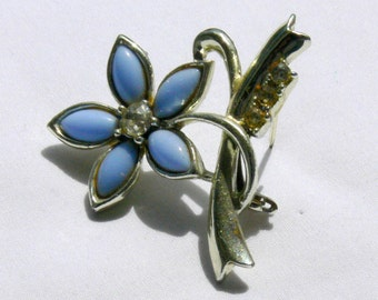 blue flower brooch and rhinestones