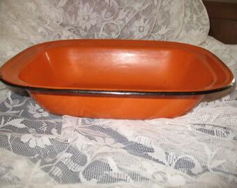 Enameled flat rectangular burnt orange.