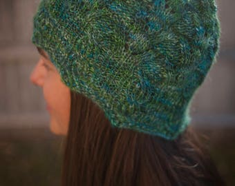 Hand knit delicate green lace hat