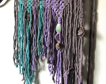 Handmade industrial boho macrame wall hanging on a shovel with crystals