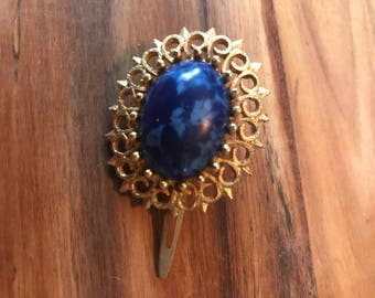 Vintage blue and gold hair clip.