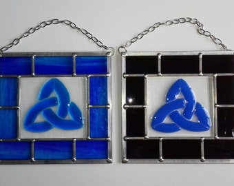 Handmade fused glass Celtic panel with traditional leaded framing.