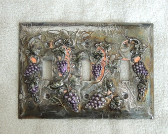 Pewter and copper covered light switch plate with grapes
