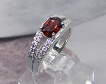 Ring size 54 on silver Sterling and Garnet oval stone