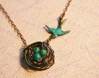 Birds Nest Necklace in Antique Copper with Sparrow Flying to Nest