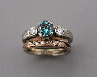 Mokume gane wedding set with a Blue diamond.