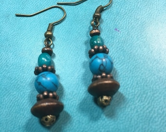 Turquoise and copper dangle drop earrings.