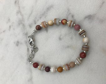 Single strand bracelet with silver accents and Mookaite stones