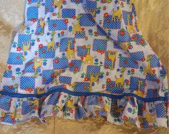 Vintage childs' whimsically fun sundress. Giraffes eating, flowers and random blue polk-a-dot blocks all in one!