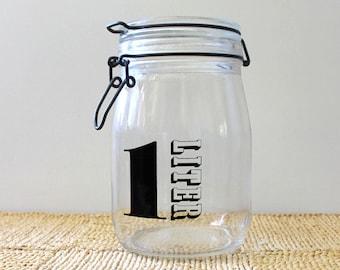 Typography. Vintage 1970s French glass jar. One liter.