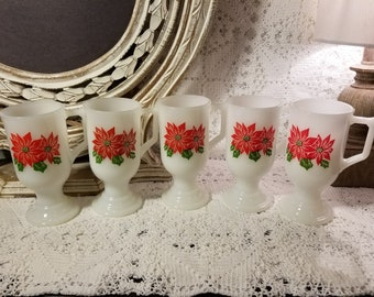 Milk glass pedestal mugs with poinsettias
