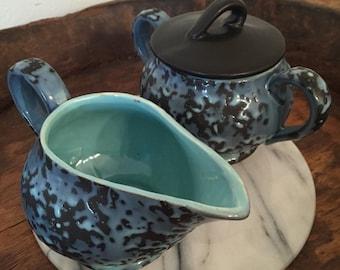 Vintage McCoy Brocade Blue and Black Pottery Sugar Creamer Set with Aqua Interior and Black Lid