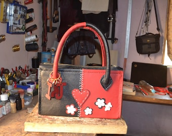 Genuine leather fully customized handcrafted woman's hand bag.