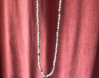 Long beaded crescent necklace