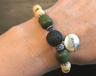 Beaded stretchy beige black green and silver aromatherapy bracelet