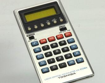 Vintage Liquid crystal calculator with alarm watch TOSHIBA LC-833WA