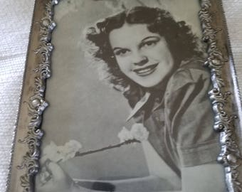Silver framed Judy Garland photo