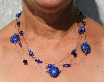 Blue necklace on twisted wire