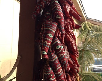 Ristra Made From Cloth Set of 7 Chili Peppers Cut From Cloth in different patterns.