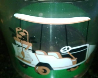 Vintage lucite ice bucket with golf theme. Vintage golf cart and 9th hole.