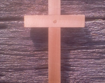 Handcrafted wooden cross made from maple.