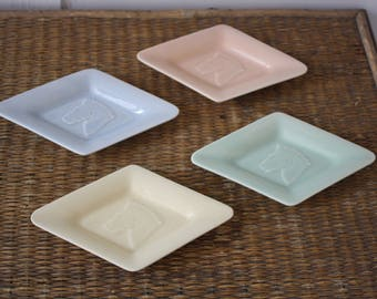 pastel serving dishes, four small pastel dishes, butter pats, horse head dishes