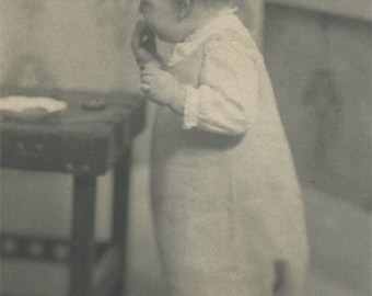 vintage photo 1910 Little Boy Child in Night dress Eating a Cookie