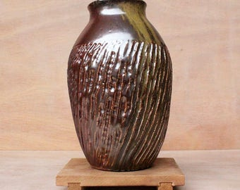 Wide mouth wood fired vase with diagonal grooves