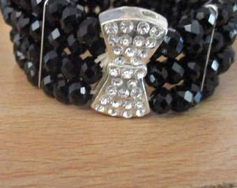"vintage black shine bead 8.5""bangle with diamante bow in great condition 1""wide"