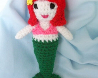 Little Mermaid crocheted doll.  Made with bright colors of pink, green, red and stuffed with fiberfill.  7 inches tall.
