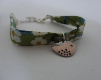 Floral green and white flowers and bird charm bracelet