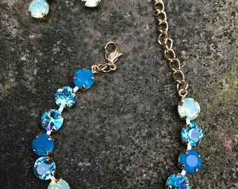8mm swarovski carribean blue bracelet and earrings