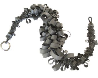 rubber ruffle necklace,  charcoal gray statement piece, designer fashion by Frank Ideas