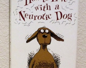 How to Live With A NEUTOTIC DOG by Stephen Baker, Illustrated by Fred Hillard