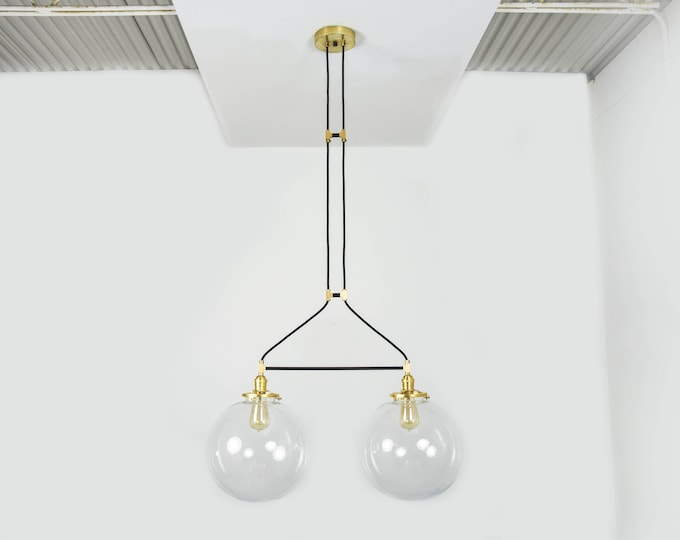 Matte Black and Raw Brass Gold Pendant Light with Clear Globe Vanity Modern Mid Century Industrial
