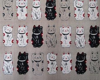 Fabric Japanese manekineko beige background 50 x 55 cm